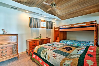 The property is filled with comfortable home furnishings and lake-themed decor.