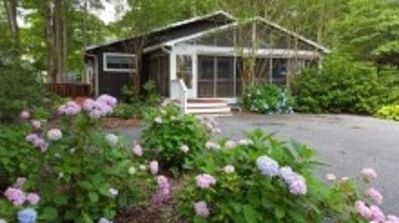 Photo for Walk to town and beach; 3 living areas; family friendly with pools and tennis