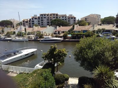 Photo for Beautiful modern apartment sea view and marina in Port-Grimaud 2 steps from the beach
