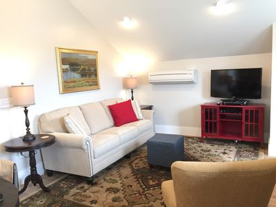 Living area with LED HDTV and heat/AC unit