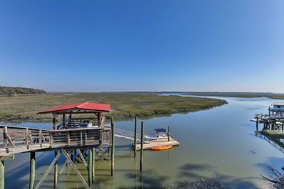 Welcome to 'Baisden Bluff,' a spectacular 4-bedroom, 3-bathroom vacation rental home in Townsend, Georgia!