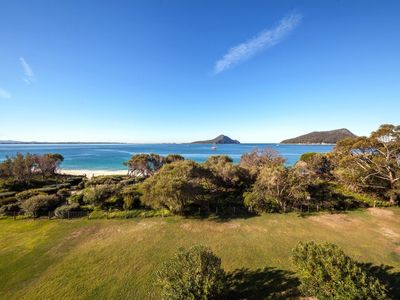 Photo for Sit back and enjoy panoramic views over Shoal Bay to the Headlands.