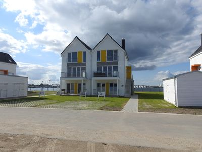 Photo for 3 room duplex apartment with fireplace, sauna and whirlpool, right on the water