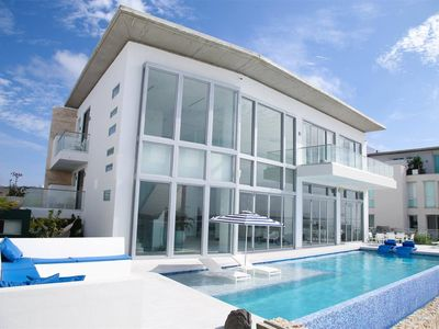 Exclusive Beachfront villa with gym, pool and in-house maid