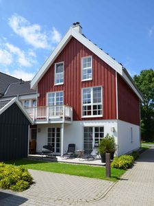 Photo for Luxurious apartment in top location in Greetsiel with private hot tub and fireplace