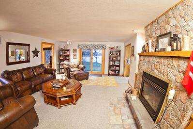 Big, luxurious leather furniture in living room. Cozy fireplace.