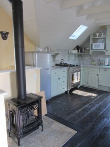 Lopi gas stove to keep things cozy during the winter, orig restored barn floors