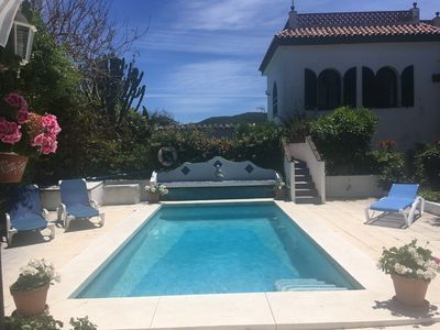 Photo for Rustic villa in walled garden on beach near Tarifa with heated pool. .