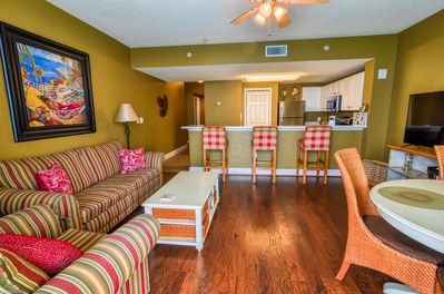 Wooden floors complete the living rooms look with big comfy couches Flatscreen tv!