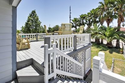 Enjoy tranquil views with many palm trees from the large deck of your backyard.