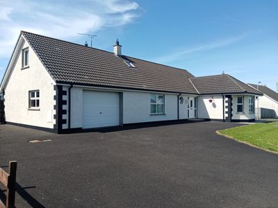 """Photo for """"Sea Shells"""" a beautiful 6 bedroom chalet type bungalow in Castlerock (NITB)."""