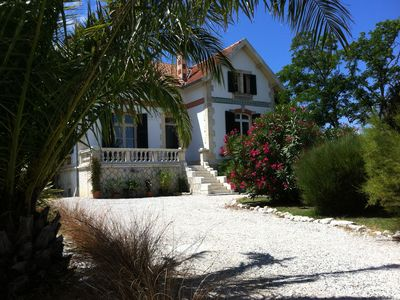 Photo for 4 star villa with sea view, islands, natural area, private heated pool, spa
