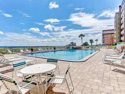 Photo for Top Floor 3 Bed/2 Bath Oceanfront condo, remodeled kitchen with a W/D in the unit , sleeps 7.  Amenities include pool, community grills, private fishing pier and tennis courts!