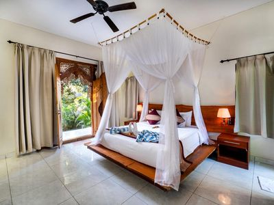 Photo for Balinese Style House with Public Swimming Pool, Close to Mushroom Beach (DLX)