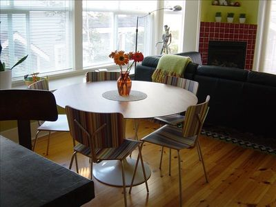 Kitchen table seats six  and wall length bay window