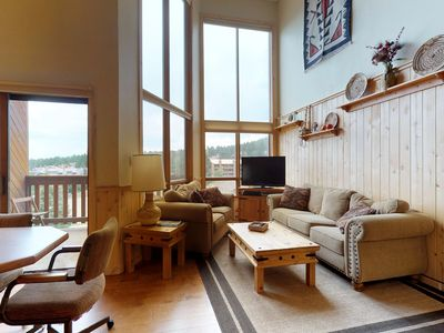 Photo for NEW LISTING! Mountain view condo w/ fireplace, deck & jet tub - 300 feet to ski