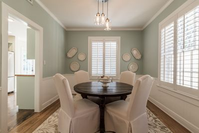 Antique dining table comfortably seats up to six people with dimmer lighting.