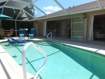 Prime location with heated pool, updated furnishings and open floor plan.