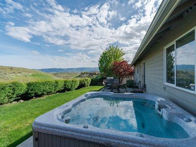 Photo for Sleepy hillside home features private hot tub and great location!