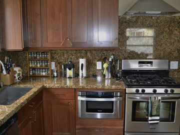 Awesome kitchen with Thomasville cabinets, granite counter tops, drawer microwav