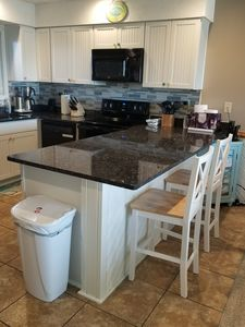 Photo for You'll love Sea Glass. Semi-oceanfront condo. Steps from the beach. Free linens