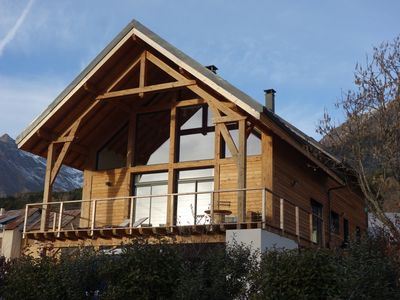 Photo for Contemporary chalet on the heights of Lake Serre-ponçon