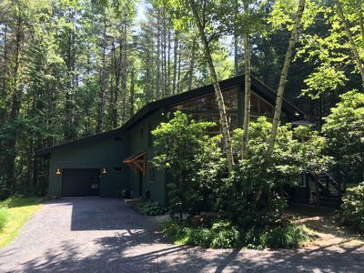Secluded, renovated, 4 BR, 3 bath modern home on 10 wooded acres.