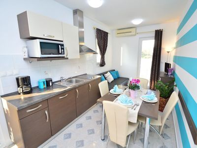 Photo for Lovely apartment for 4 people with WIFI, A/C, pool, TV, balcony and parking