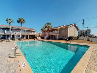 Photo for Ocean view condo w/ shared pool & large balcony - steps to the beach!