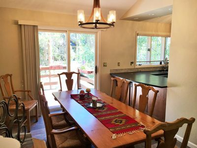Dining room w/ seating for 8. Extra seats at the breakfast bar & kitchen table