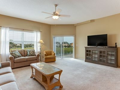 Photo for 2 bed 2 bath condo-open floor plan, sleeps 6 .  Waterfall pool & hot tub in private setting.