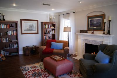 Cozy living room with lots of books and oversized chairs.  Enjoy!