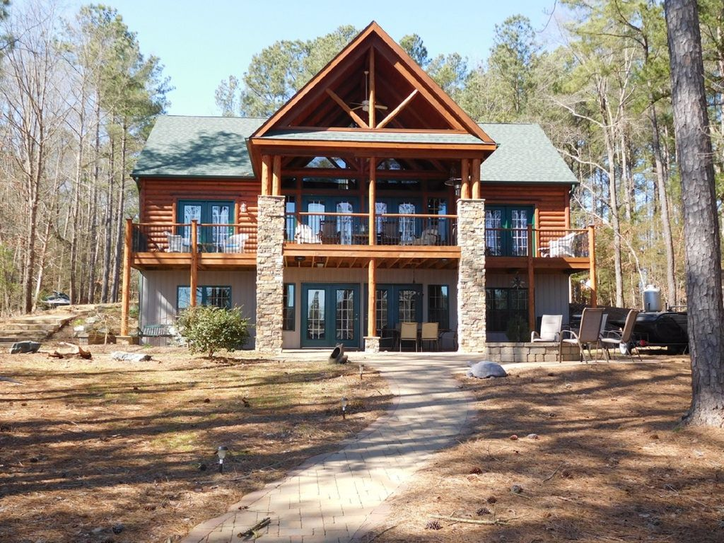 Rustic elegant log home pizza oven paddl vrbo Lake gaston rentals with swimming pool
