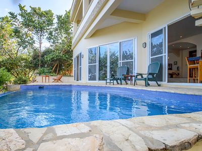 Photo for Oceanfront, modern home with private pool, beach, and rooftop deck