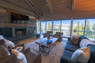 Large open living room with 30ft ceilings and mountain views!