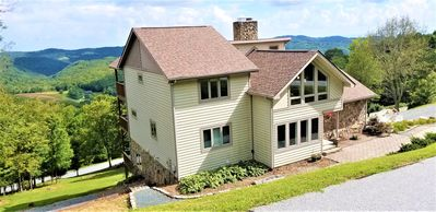 Photo for 80 mile view, Free WiFi, pool table, hot tub, fire pit, large rooms, private loc