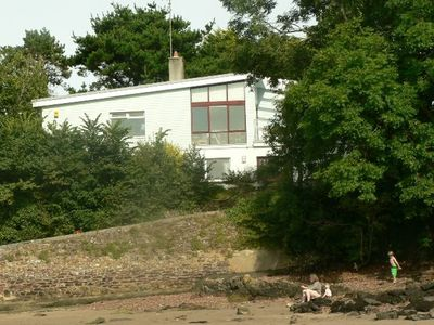 Photo for Secluded beachside 4 bed house, family & dog friendly, stunning creek views