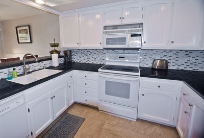 This is the remodeled kitchen with granite, dishwasher, upgraded appliances