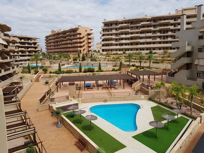 Photo for Stunning beach views of Arenales del Sol in 5 pools urbanization