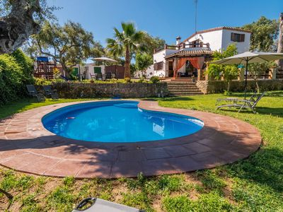 Photo for Beautiful Villa with Large Garden, Pool, Jacuzzi, Terraces, Air Conditioning & Wi-Fi; Parking Available, Pets Allowed
