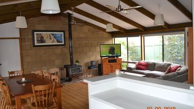Large entertaining area with TV, Fireplace Dining Table, Large lounge & kitchen