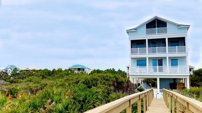 """Photo for Ready to rent now! Great Vacation? Rest Assured! Beach Plantation w/ Pool, Screened Porch, Elevator, 6BR/5.5BA """"Rest Assured"""""""