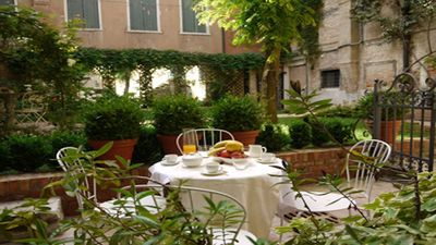 Photo for Charming apartment with garden in the heart of Venice