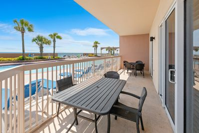 Dine al fresco with views of the pool and Gulf