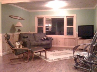 upstairs living room. views of lake, walks out to deck