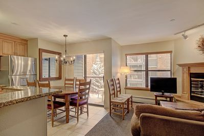 This condo features 1200 sq. ft of space and boasts an open-concept living area.