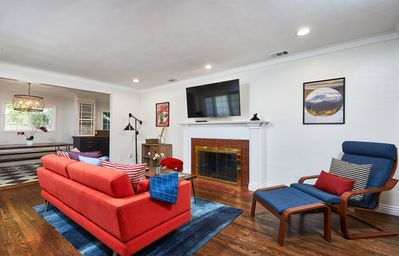 """Living room with 55"""" TV loaded with all cable and designer Bludot sleeper sofa."""