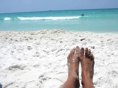 Soaking up the sun with your feet in the sand....