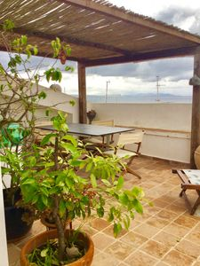 Photo for Apartment in the heart of the historic village with two magnificent terraces overlooking the sea