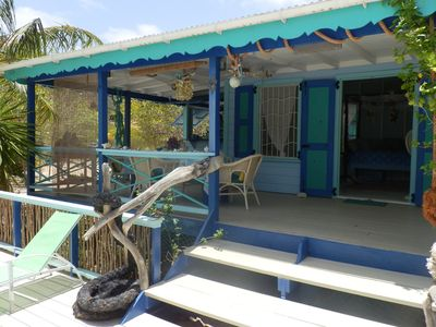 The covered top deck gallery is ideal 4 eating, relaxing or lying in the hammock